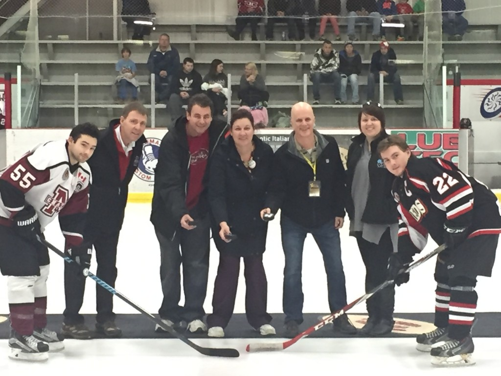 """Chatham Maroon President - Bill Szekesy, Chatham Goodfellows - Tim Haskell, Rose Peseski and Dave Palmer and Amanda Thibodeau perform the ceremonial """"puck drop"""" at centre ice yesterday afternoon at the Chatham Maroon hockey game."""